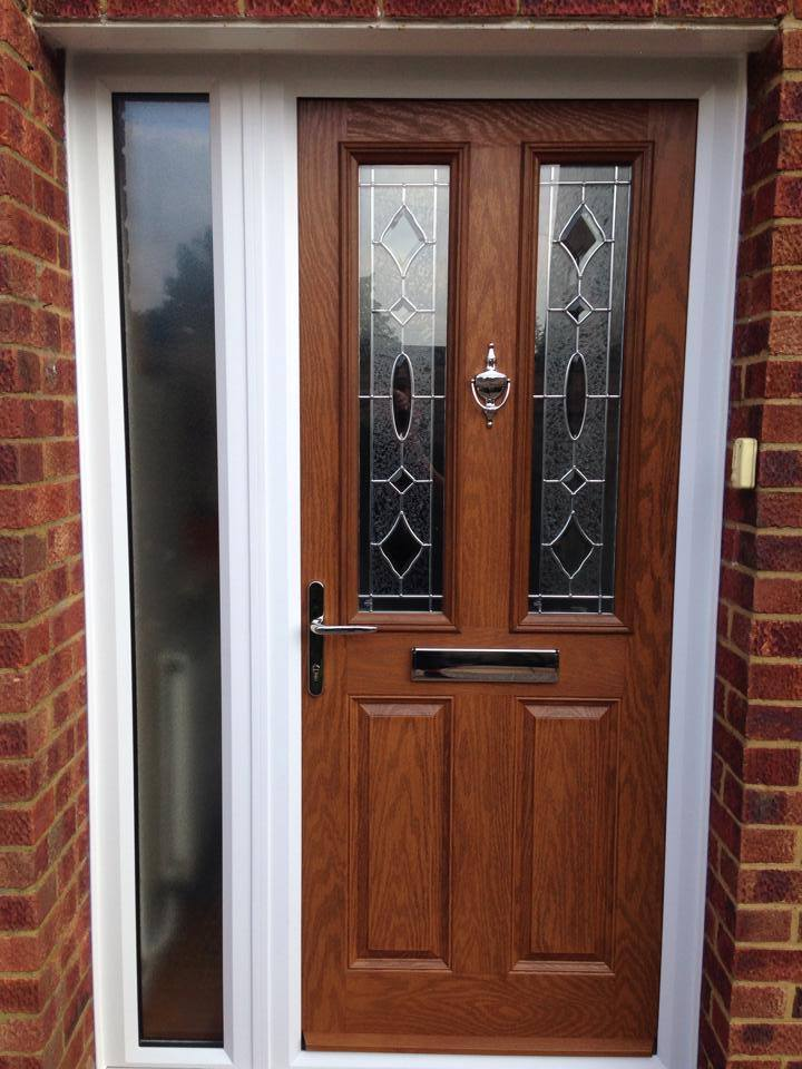 Oak composite front door with zinc art clarity glass, finished with contemporary chrome furniture.