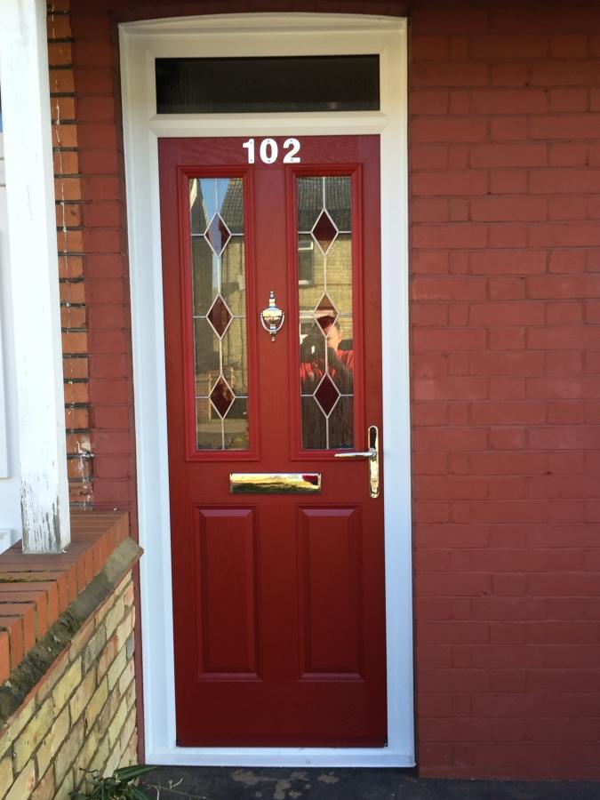Red composite front door in Biggleswade