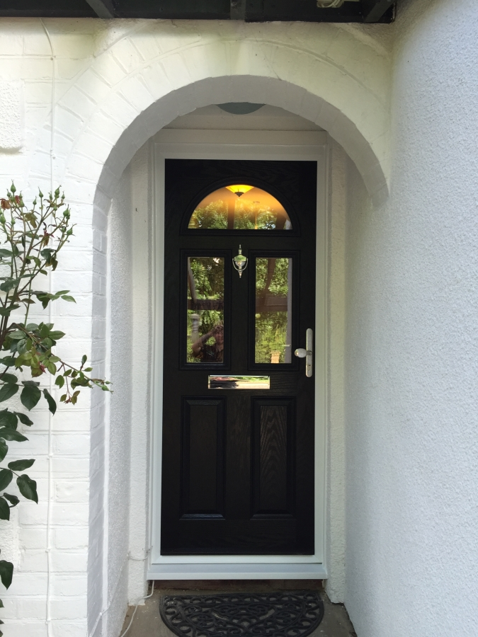 Black composite front door with chrome furniture