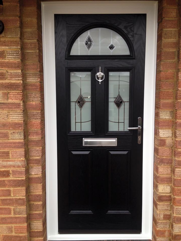 Black composite door installed with Murano glass and graphite furniture.