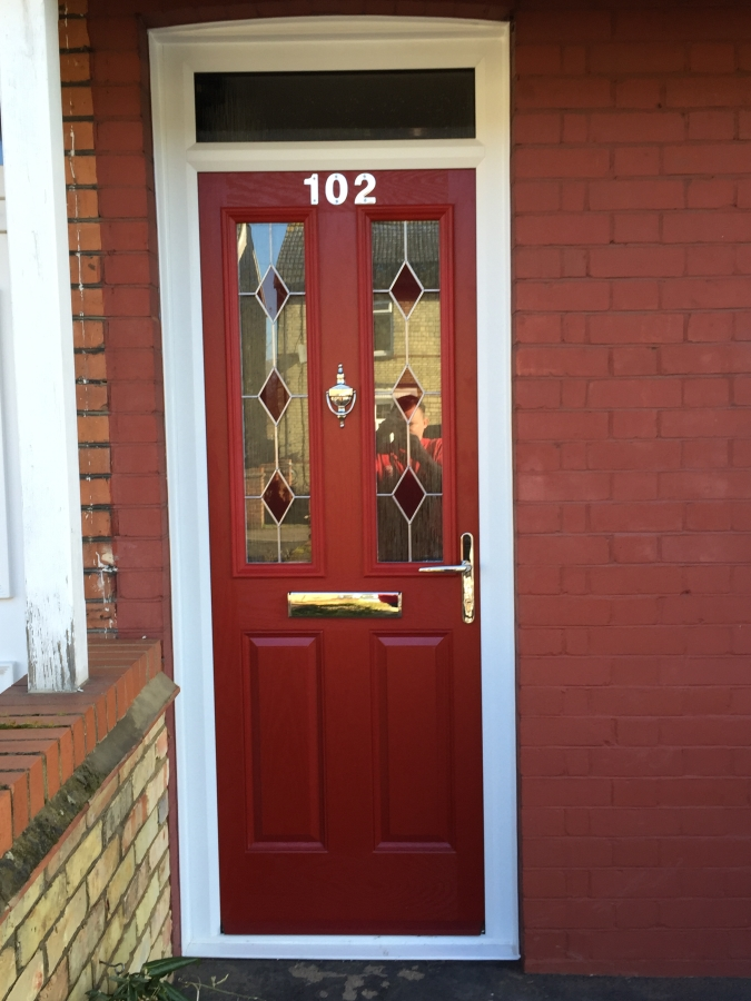 Red composite front door in Biggleswade