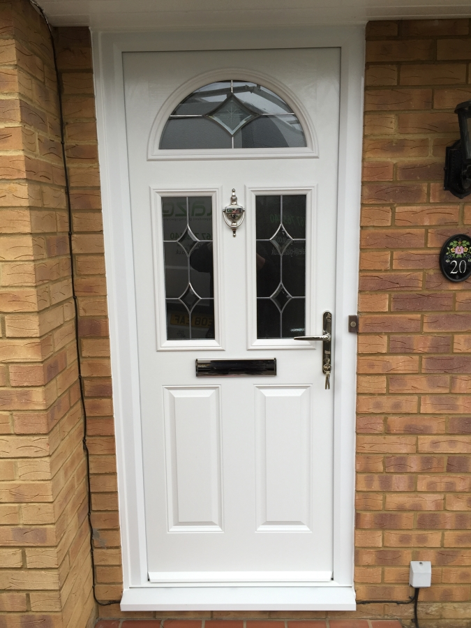 White composite front door fitted in Biggleswade