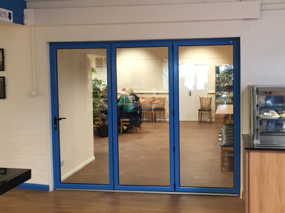Blue Bi fold doors fitted for shuttleworth air collection