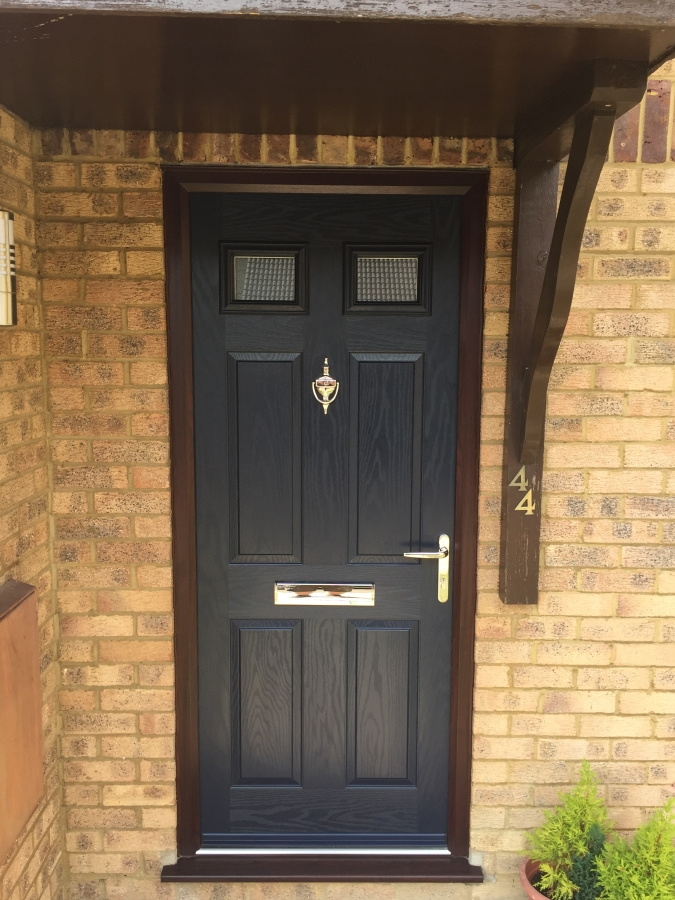 Rosewood frame and blue composite front door