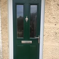 Green Composite Front Door With White Frame